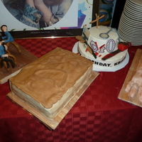 Evil Dead Theme 3 cakes - The necronomicon (s'mores cake covered in modeling chocolate,) Ash's severed hand (jelly roll, complete with bones,)...