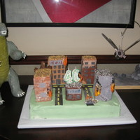 Godzilla Vs. Mothra Godzilla, Mothra, and buildings made from RKT and fondant; cake is half choc w/choc butter cream and half WASC with van buttercream. The...