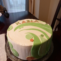 Circle Designs Another b-day cake. Iced in butter cream, white modeling chocolate accents.