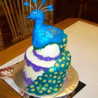 Peacock Birthday Cake I've admired the huge peacock wedding cakes I've seen here & wanted to try a small version. 2 tiered 6 inch & mini ball....