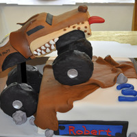 Monster Truck Cake   Monster truck cake made for a 3 year olds birthday. Thanks CC'ers and jessiescakes.