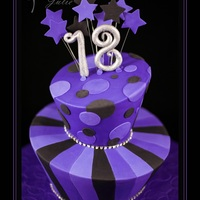Purple Whimsical Topsy Turvy This funky 2 tier Topsy Turvy cake was a milk chocolate mud cake with yummy milk chocolate ganache. Decorated in the purple and black theme...