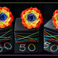 Rainbow Rose This Rainbow Rose cake is enough to brighten anyone's day. This was made for a lovely lady that loves rainbows and roses..... so to...