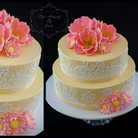 Summer Beauty A beautiful wedding cake n the gorgeous colours of butter yellow and peachy pink! The open peonies and daisies are all hand-made from sugar...