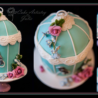 Birdcage & Blossoms This gorgeous birdcage cake is pretty and feminine, with its soft colours, pretty flowers and little silver bird. It's a yummy Cherry...