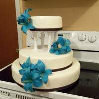 Round With Turquoise Flowers The bride wanted all dummies. This is my first official wedding cake. Once I delivered, the bride added a top. It shows in the second...