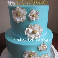 Teal And Gold Buttercream cake with gumpaste flowers.