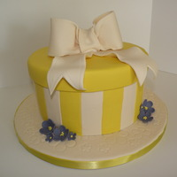 Spring Time Hat Box Cake Hatbox inspired cake. Bow and flowers are a 50/50 mix. Cake is fondant. Extra flower detailing on the cake board. Loved how feminine it...