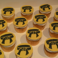 Black Belt Cupcakes Black belt inspired cupcakes made with a karate school logo. Fondant toppers with royal icing.