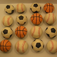 Sports Cupcakes Sports themed cupcakes. Basketball, baseball, and soccer. All covered in fondant. Basketball lines piped with royal icing. Had a blast...