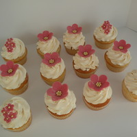 Flower Pearl Cupcakes Floral inspired cupcakes. Fondant decorations with sugar pearl centers.