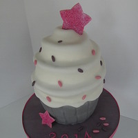 Glitter Dance Star Cupcake Cake Giant cupcake cake for a dance star! All fondant and sculpted (no cake pan used). Used disco dust for decoration and super pearl for...