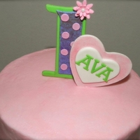 1St Birthday Girl covered with vanilla buttercream and decor is made with gumpaste and fondant. TFL!