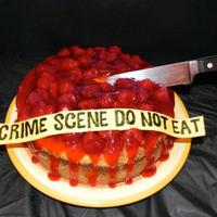 Cheesecake! For Halloween, a sweet bloody crime cheesecake with strawberry preserve topping. Just had a little fun =)
