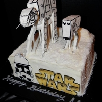 Star Wars - Battle Of Hoth (Snow Battle) Covered in buttercream and shredded coconut with fondant Storm Trooper and Star Wars logo. ATAT & ATST made of RKT and reinforced with...