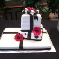 Black & White Gift Box Cake 3 tier gift box cake with red anemone flowers
