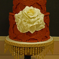 Spanish Style Wedding Cake Fondant covered cake with Gumpaste Rose (rose center is dusted with gold, rose petals dusted with pearly white).
