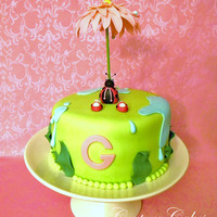 Lady Bug Baby Shower Cake Flower Umbrella is made of gum paste, the lady bug is made of fondant.