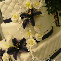 Purple Tiger Lily Quilted Wedding Cake All the flowers are made of fondant and gumpaste and hand painted or air brushed. Cake is covered in fondant with alternating tiers of red...