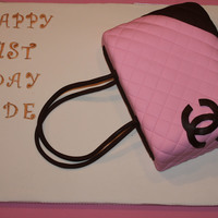 Carved Chanel Purse Carved Strawberry Cake with Buttercream and Fondant.