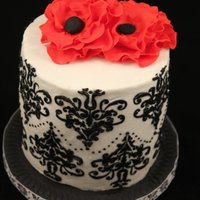 Black & White With Red Flowers Chocolate with Almond Buttercream. Used stensils and then made flowers with Gumpaste and Fondant. First time trying to use a stencil....