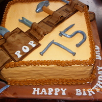 Tool Birthday Cake   Cream Cheese Frosting with a Chocolate Cake. Tools and belt are made out of fondant