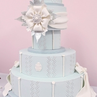 Winter Jewel The cake was inspired by the crisp elegant snowflakes that bloom in a cold winter air and falls to decorate everything they touches