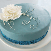 Blue Cake With White Flower