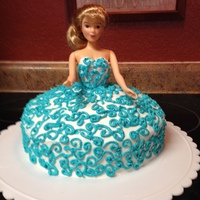Princess Swirl Dress, Made By 11 Year Old This cake was made entirely by my 11 year old daughter. She wanted to practice the swirl design she had been working on, on paper. So she...
