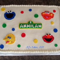 Sesame Street Cake 1/2 strawberry sheet cake with whipped buttercream and fondant accents.