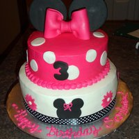 Minnie Mouse Cake Buttercream finish with fondant accents.