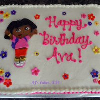 Dora Cake 1/2 strawberry sheet cake with whipped buttercream and fondant accents.