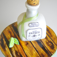 Patron Cake Patron Cake, Chocolate with chocolate frosting, fondant and modeling chocolate mix for the decoration, edible gel colors for wood grain...