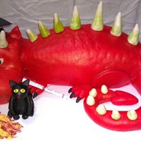 Dragon Cake Graduation dragon cake. Made the tail with cake and frosting and molded it in shape. Covered it in three peices, head, body, then tail....