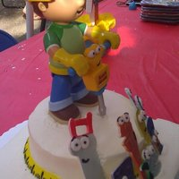 Bob The Builder Cake I made the tools out of gumpaste and airbrushed them. The topper is a toy.