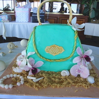 Purse In The Sand I made this cake for my friend's bridal shower. this was my first attempt at sculpting cake, making a purse, and gum paste orchids. I...
