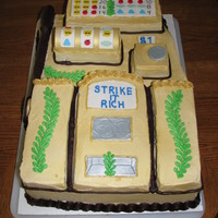 Slot Machine Cake  Madeira cake was covered and decorated with buttercream frosting, gum paste for the detail artwork. The cake was sprayed with gold food...