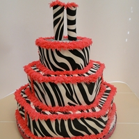 Zebra Print With Pink Trim Birthday Cake This cake was made with the hexagon cake pans, covered in BC icing and then wrapped with edible cake images, then trimmed with pink BC...