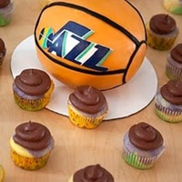 Utah Jazz Basketball Cake  Mini basketball Utah Jazz Cake. White cake & cupcakes colored with the Utah Jazz colors. Chocolate ganache frosting. Orange fondant...