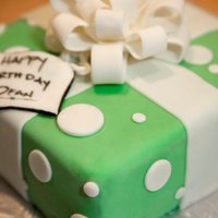 Polka-Dot Present Cake Green fondant with white fondant polka-dots and bow