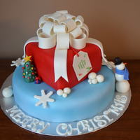 Christmas MMF to cover the cake and mmf mixed with gum tex for the bow and sculpted pieces.
