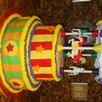 Carousel Birthday Cake This is my 2nd tiered cake and it came out so much better than the first. Its a 12 inch and a 9 inch vanilla cake covered in buttercream...