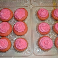 Mini Strawberry Cupcakes w/ vanilla buttercream tinted pink.