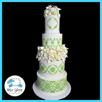 "Cala Lily & Roses Stenciled Wedding Cake Four tiered wedding cake with one separator tier, size is 4,6,8,10"" rounds with a 5.5"" tier height. We used a stencil from..."