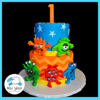 Funny Monsters 1St Birthday Cake We designed this cake based off of the invitation - with funny, happy monsters and bright colors!