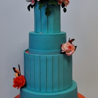 Turquoise/coral Wedding Cake This is my very 1st wedding cake. The highest I ever made were wedding anniversary cakes. I promised a friend since last year that I would...