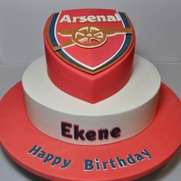 Arsenal Themed Birthday Cake This cake was made for a true Arsenal fan.....he so loved this cake he refused to cut the top tier for a week....oh dear...seems people...