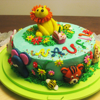 Safari Themed Cake chocolate cake with vanilla buttercream decorated with fondant animals and accents