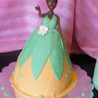 Princess Tiana Birthday Cake  This is a cake I did for a dear friend of mines little girl. The doll is a real princess doll with plastic wrapped at the bottom half for...