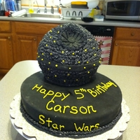 Death Star From Star Wars This is a chocolate cake with pastry cream filling. 10 in round cake covered in fondant. Death Star is the 6 in Wilton sports ball pan...